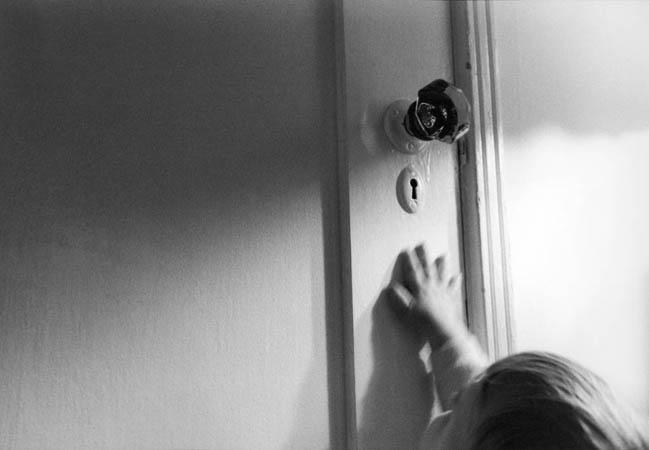 Lukas Reaching for Doorknob.jpg