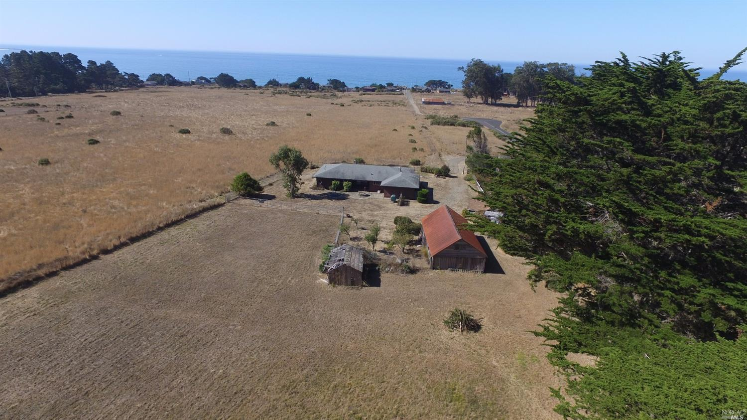 Irish beach homestead with usable acreage and multiple structures   $510,000     Represented Seller