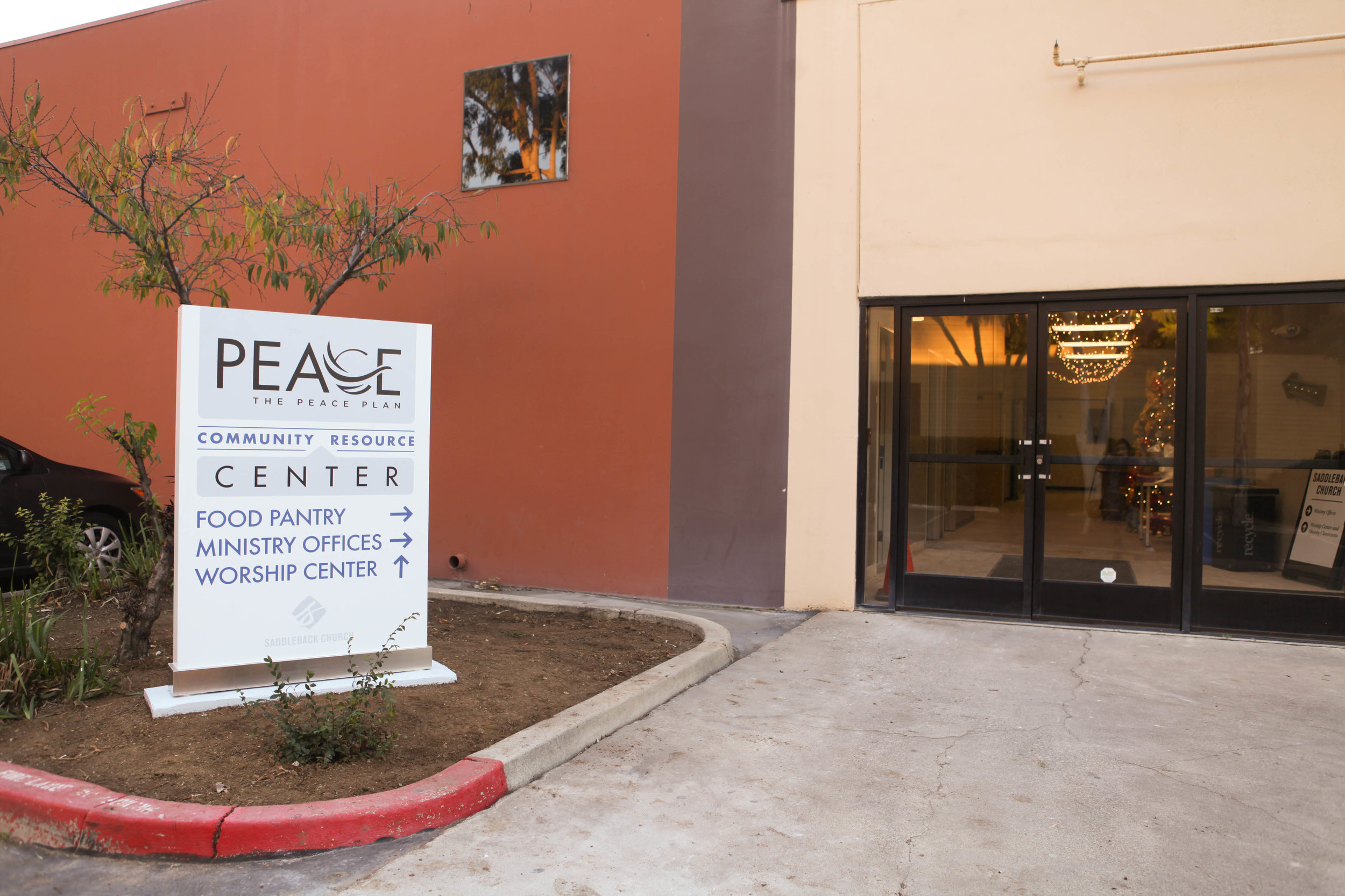 People and families in need come to the Saddleback Church PEACE Center food pantry for groceries.