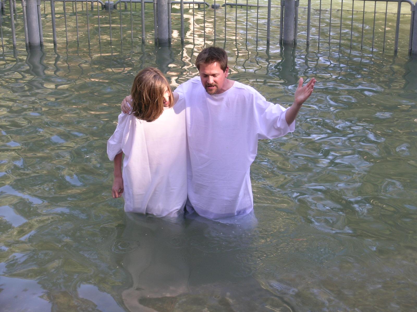 Pastor Frank baptizing his son in the Jordan River in Israel