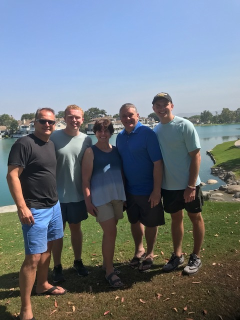 Pastor Mike reunites with longtime family friends from his Bible study.