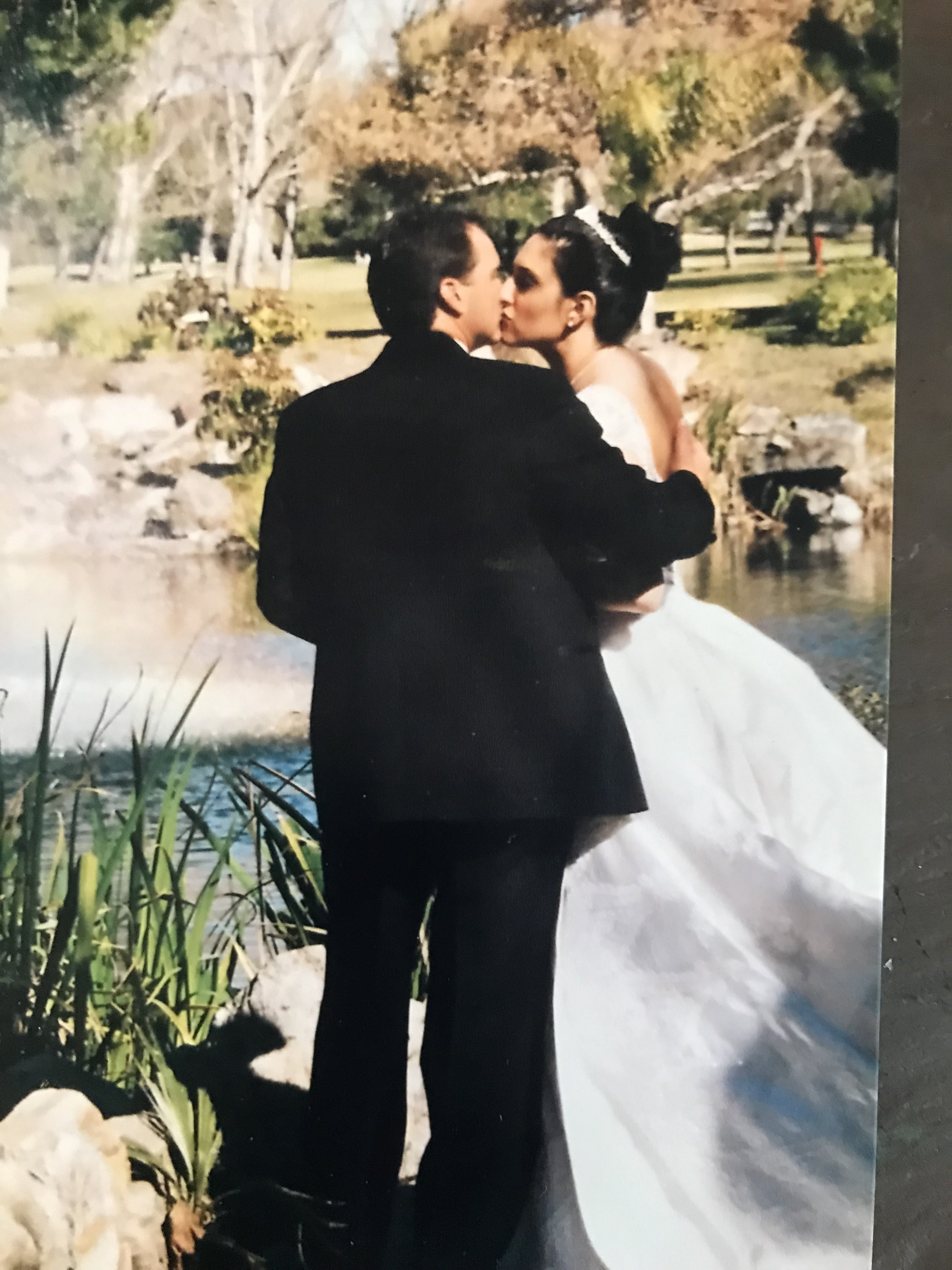 Pastor Mike shares a lakeside kiss with his beautiful bride Francheska.