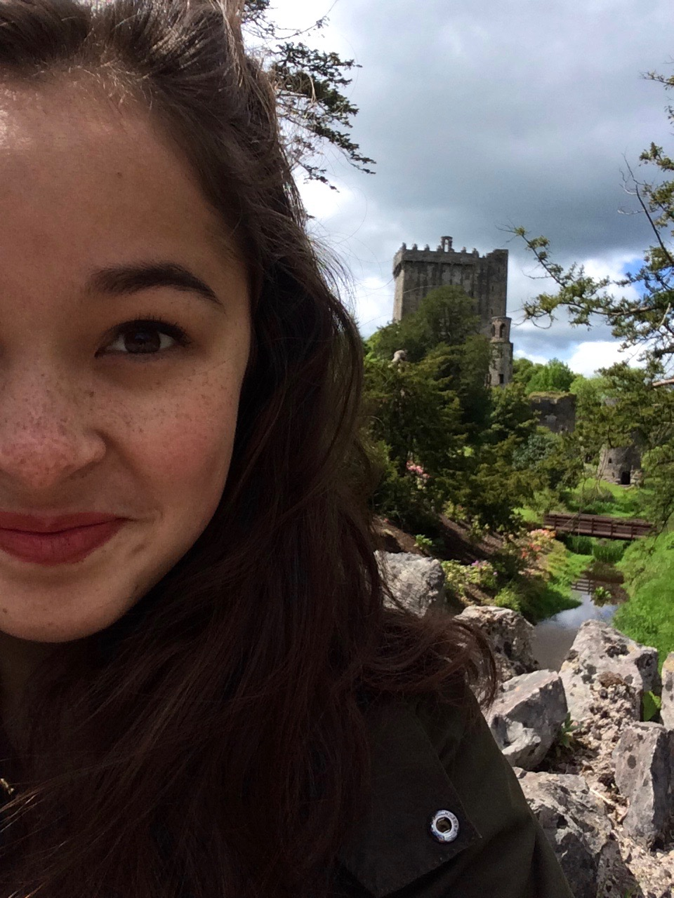 me, pretending to take a photo of blarney castle - We're all able to tell that this was just an excuse for a selfie.