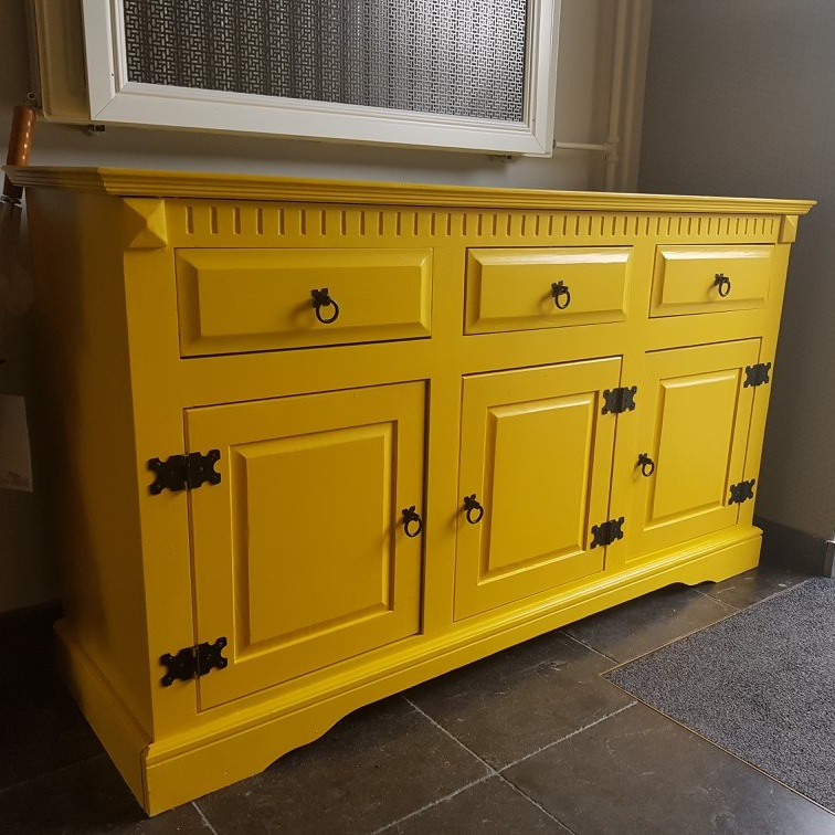 Yellow shoes-cupboard - This dresser doubles as cover for some ugly pipes from floor heating that go about 50 cm up the wall. For this project I have re-purposed an old dresser, cut out the back to accommodate the pipes and shortened two of the drawers. I then painted it bright yellow to make it a feature in this black and white hallway.