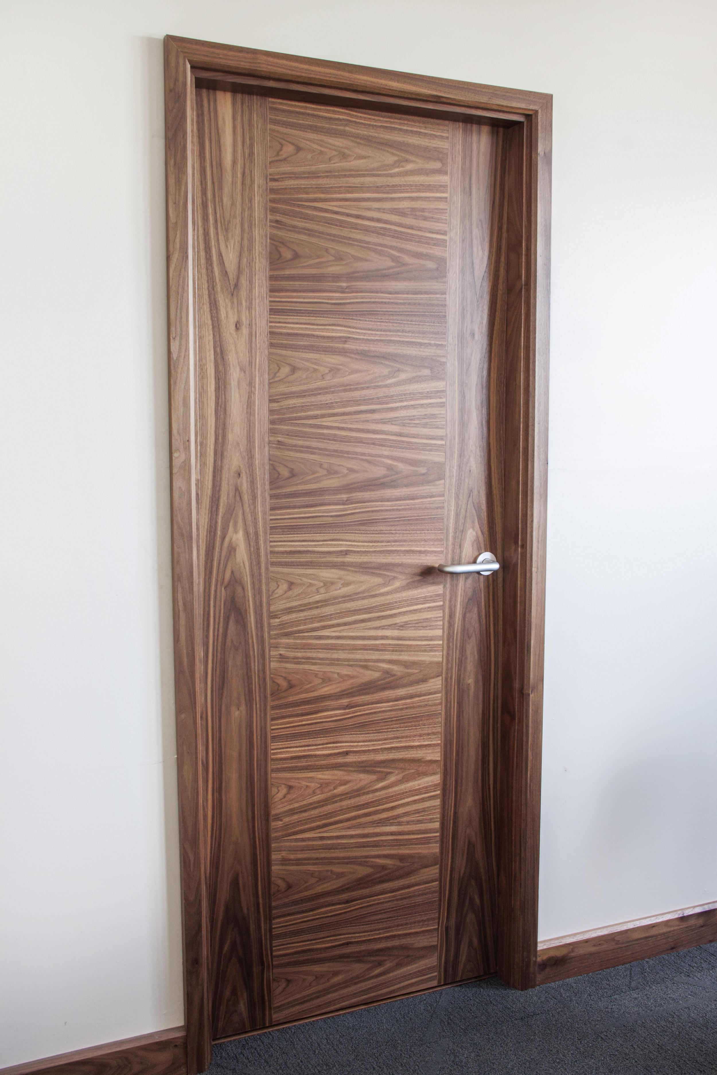 Walnut door set with horizontal veneer