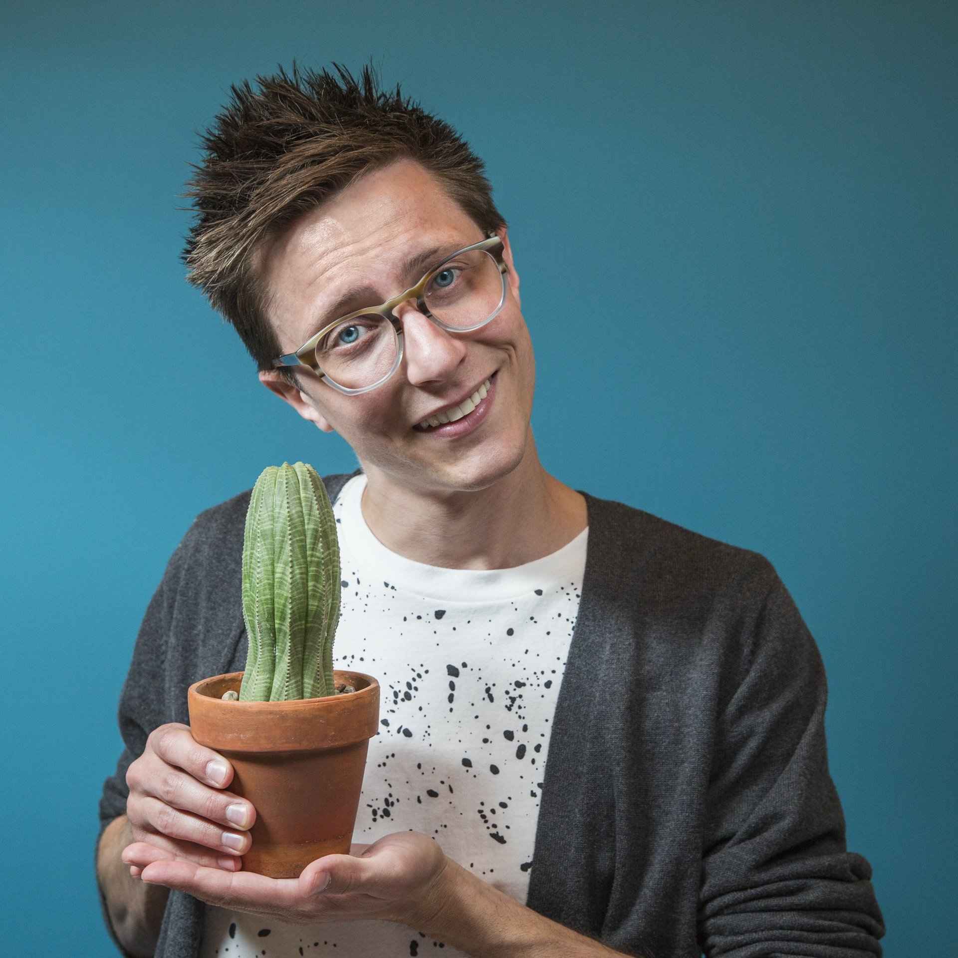 Stephen JB Thomas — design extraordinaire and amateur cactus enthusiast — posing with Frederik Reginald Pokesfield IV.