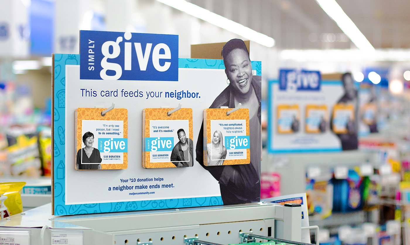 Triangle Checkout Lane display  with simple, relatable messaging. The display replaced an earlier floor stand Meijer had been using just outside their checkout lanes that obstructed guest's paths and vision, as well as obscured other products.