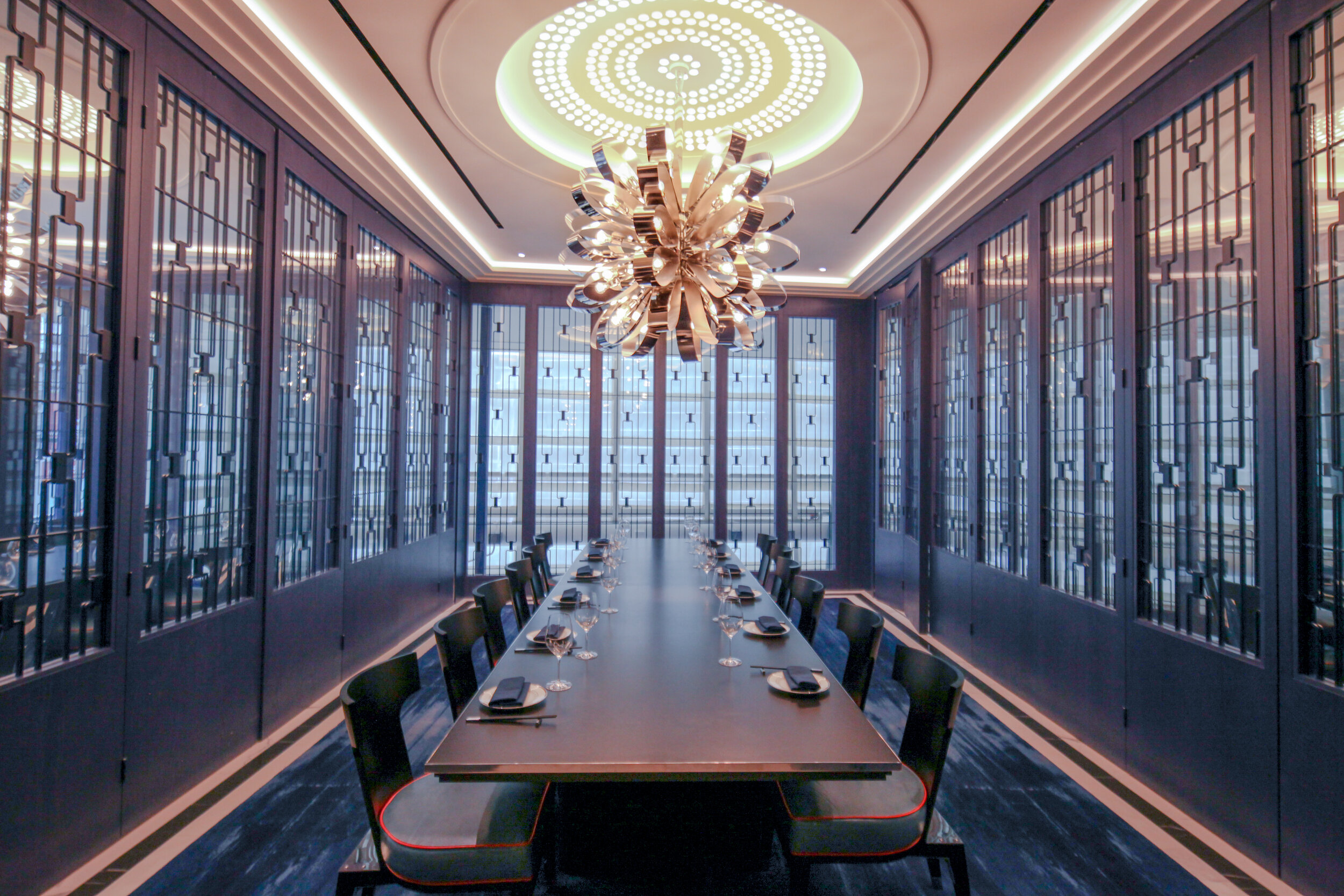 The Mao'er room seats up to 16 at one long table or up to 35 as a standing room reception. Our larger room is adorned with ink-blue latticework and accented by dragon's blood orange. The floor to ceiling lattice panel walls can open to room Luilichang.Seated-16Standing-35 - Mao'er
