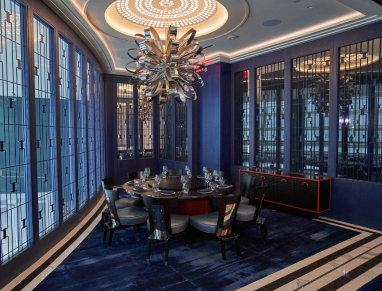 The Jiuwan room seats up to 10 at one round table as well as a standing room reception for up to 20 guests. This room is adorned with ink-blue latticework and accented by dragon's blood orange. The floors are covered in an abstract carpet, designed to resemble the misty landscapes of the Shanghai Avatar mountains. The lattice panel walls can open to rooms Mao'er and Jinyu.Seated-10Standing-25 - Jiuwan