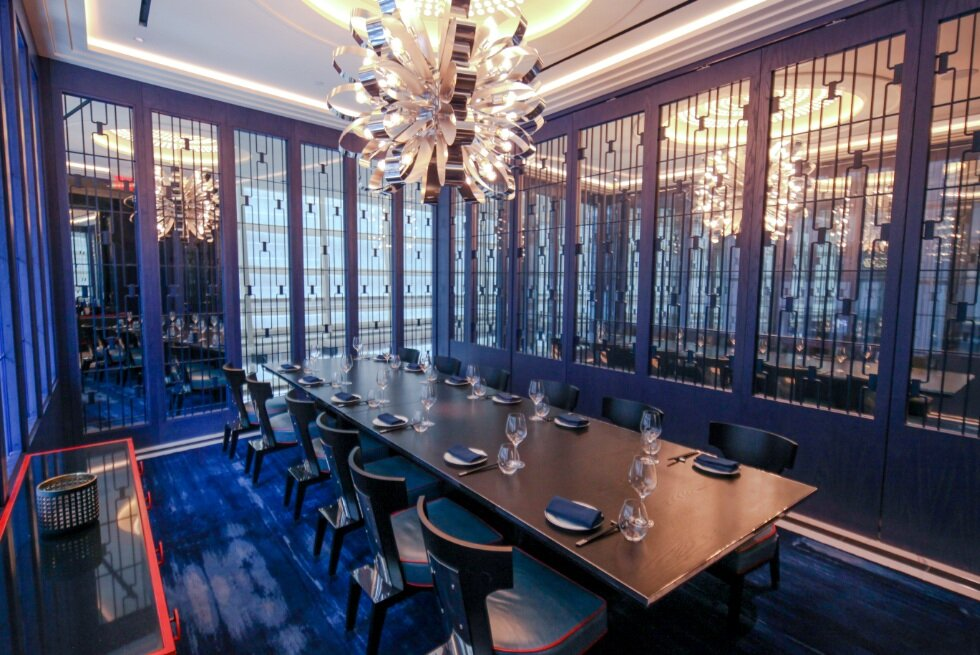 The Luilichang room seats up to 16 at one long table or up to 35 as a standing room reception.Similar in size to Mao'er, this room has windows over 58th Street. This private dining room is adorned with ink-blue latticework and accented by dragon's blood orange.Seated-16Standing-35 - Luilichang