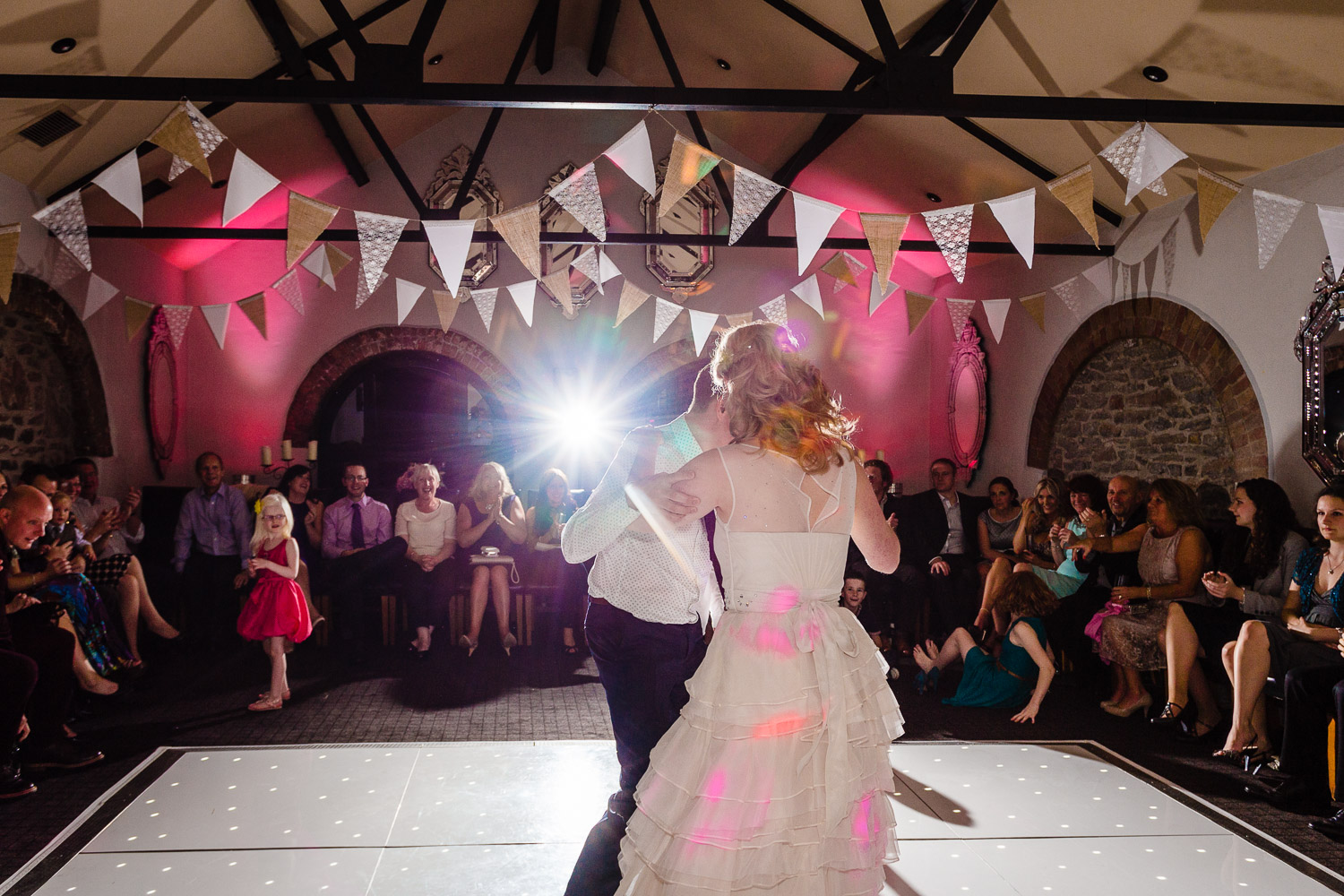 Bride and groom dancing on the lit up dancefloor for their first dance at Hotel du Vin Bristol