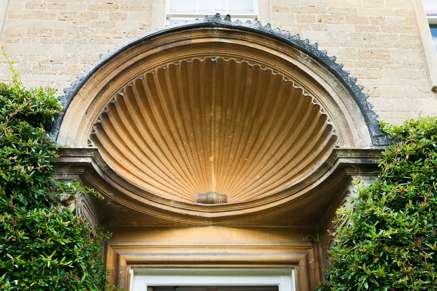 The stunning arch above the front door of the wedding venue babington house