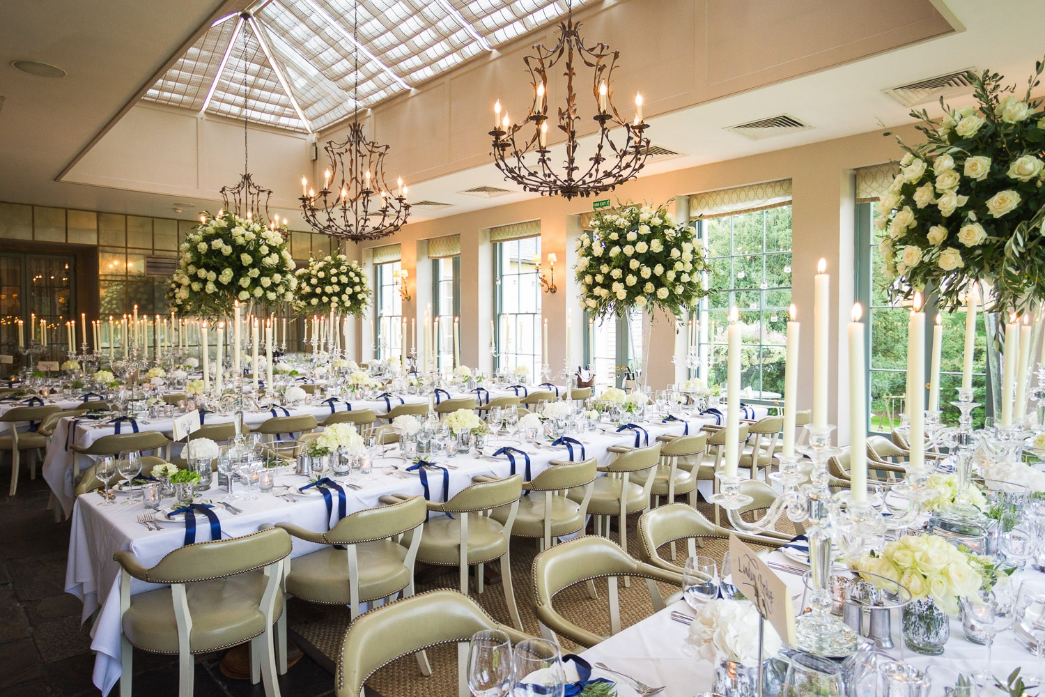 The wedding ceremony room beautifully decorated with lots of white roses