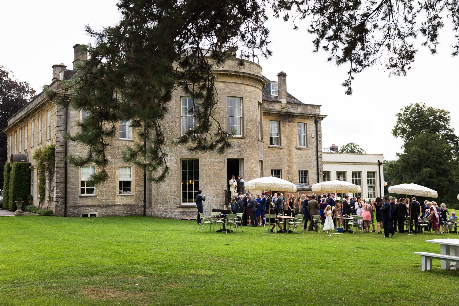 Wedding guests enjoying the outdoor space at babington house