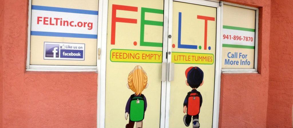 feeding-empty-little-tummies-manatee-backpack-office-exterior-1024x450.jpg