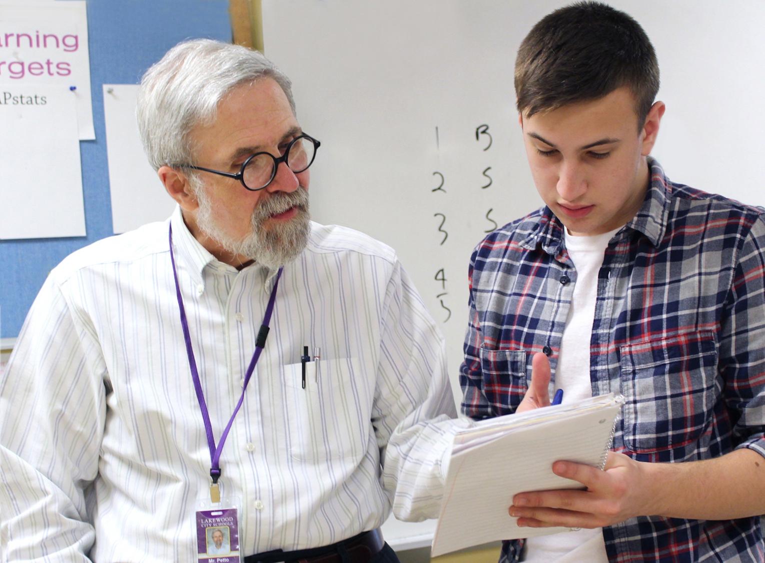 Peter Petto Outstanding Math Teacher 2017 with student.jpg