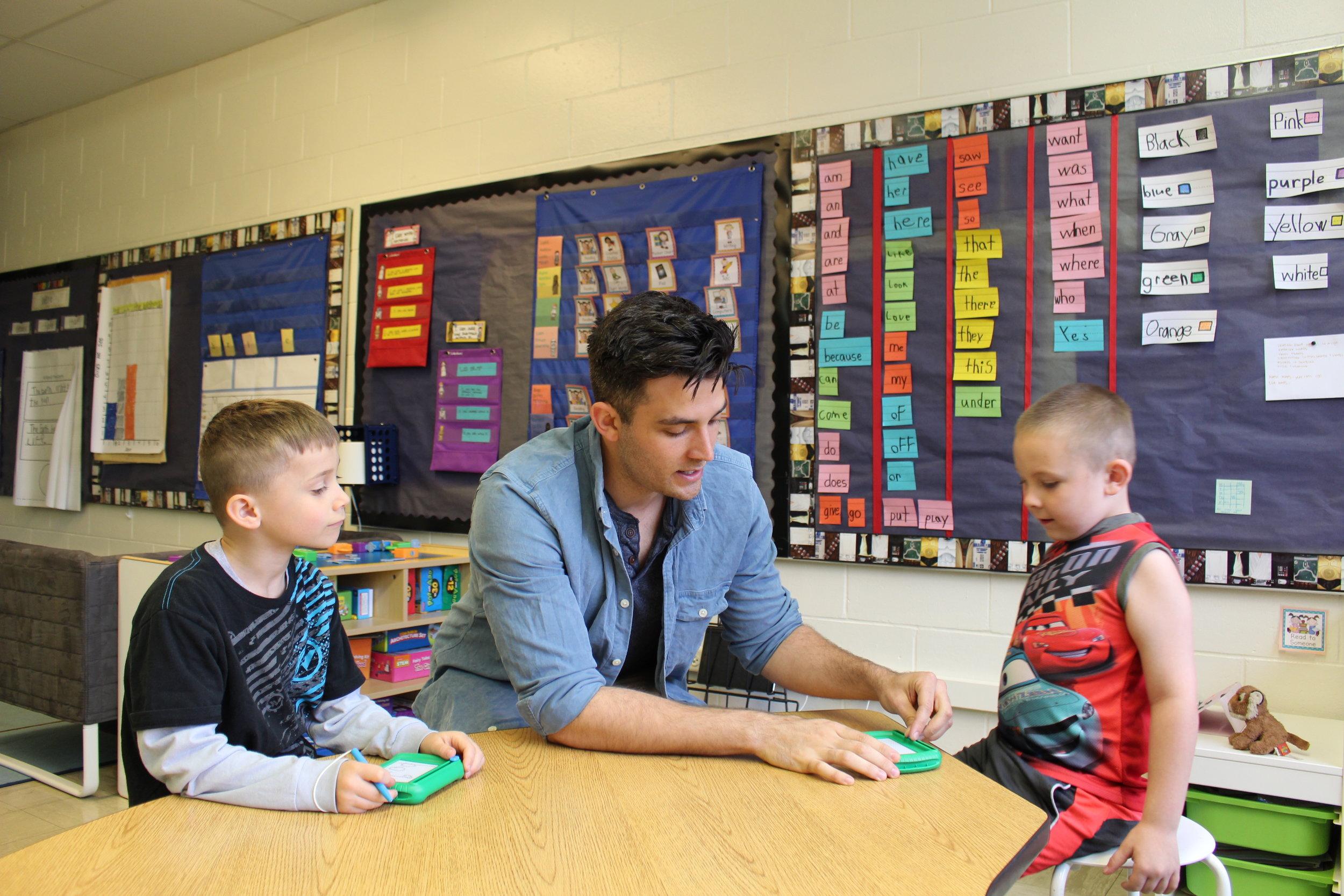 Teacher giving lesson on telling time