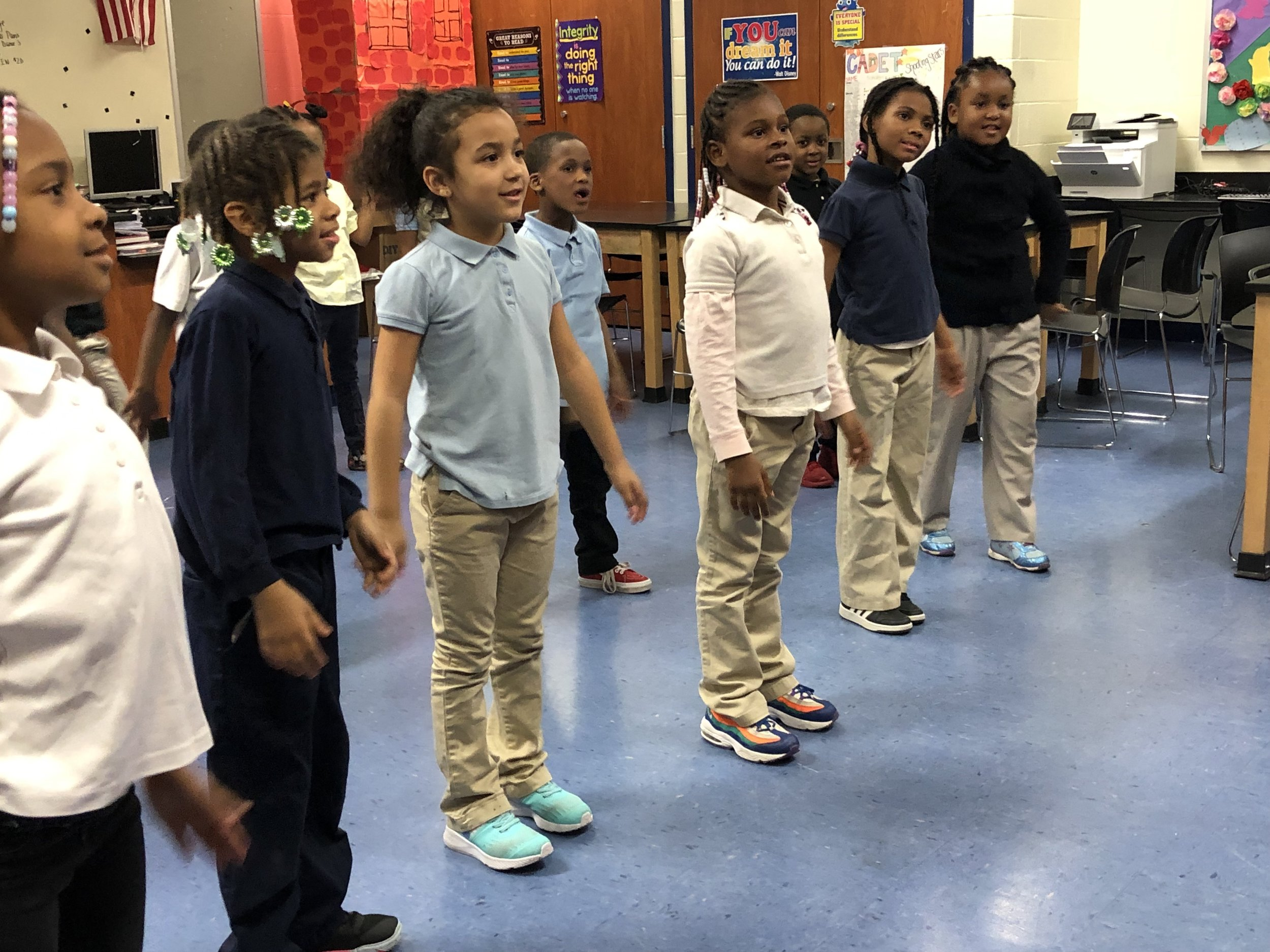Children standing up ready for activity in classroom