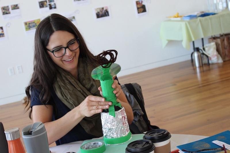 Teacher building with fun art supplies at a workshop