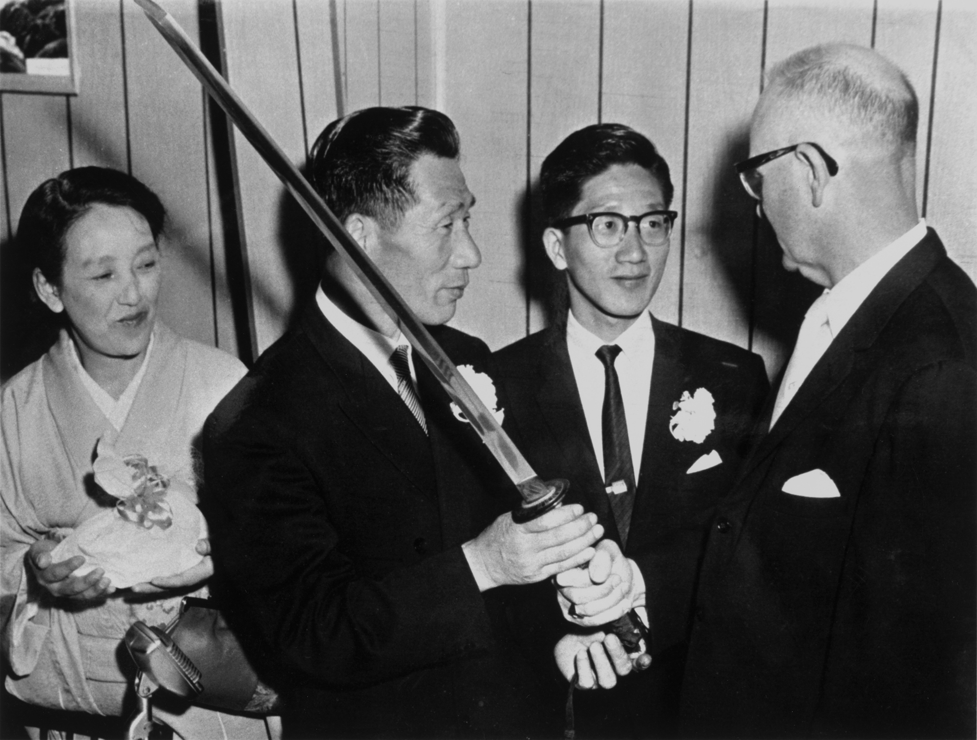 Nobuo Fujita and his family present samurai sword to Mayor Campbell, 1962