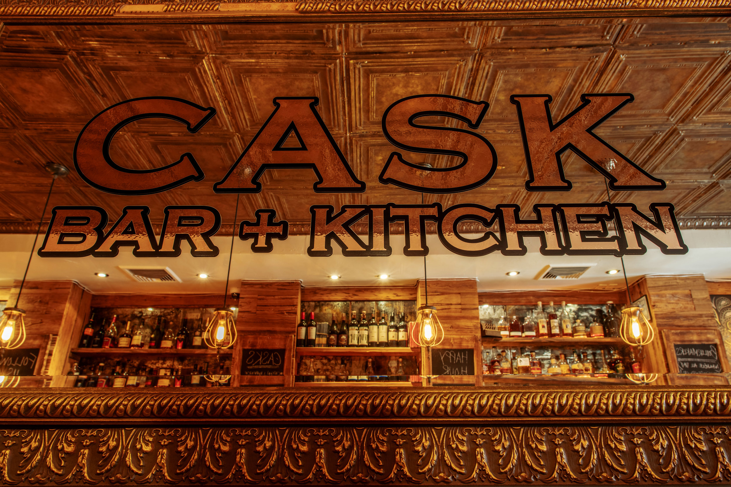 Cask Bar & Kitchen harks back to a by-gone era. - One of craftsmanship and authenticity.Of dimly lit encounters, great conversation & hand drawn ales. Well informed Barkeeps will guide the most discerning of taste buds.Creating carefully crafted cocktails and pouring a wide range of Bourbon and Rye Whiskey.