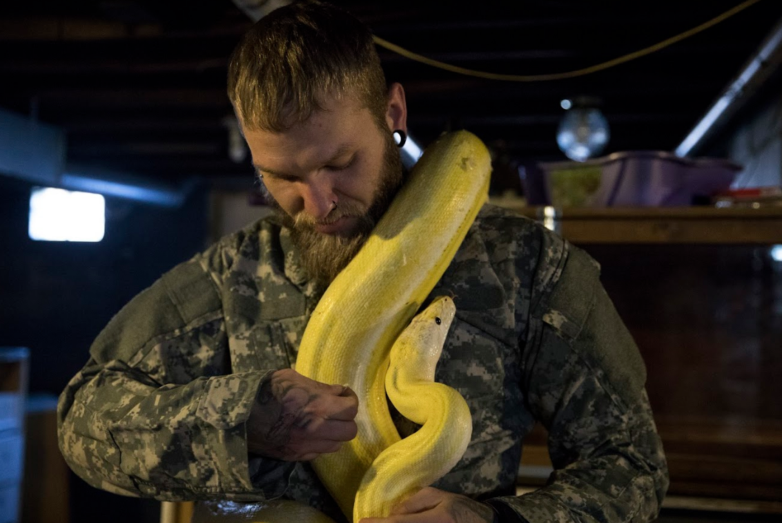 Patterson's 3-year-old, 10 foot long, Ultra-Ivory Tiger Reticulated Python, Louise. Louise is named after a character from Bob's Burgers and lives in his basement.