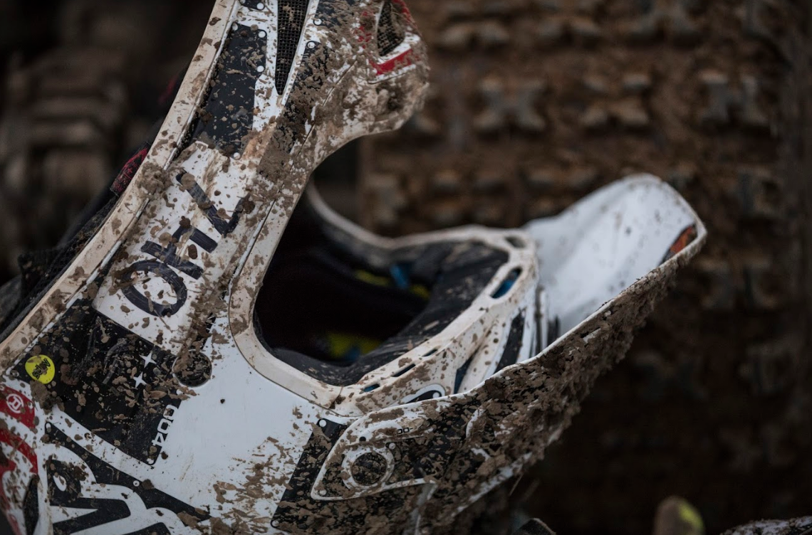 Patterson's helmet and tires splattered with mud after a long race on November 4, 2018. Patterson says getting muddy is refreshing and helps with the strain riding puts on his body.