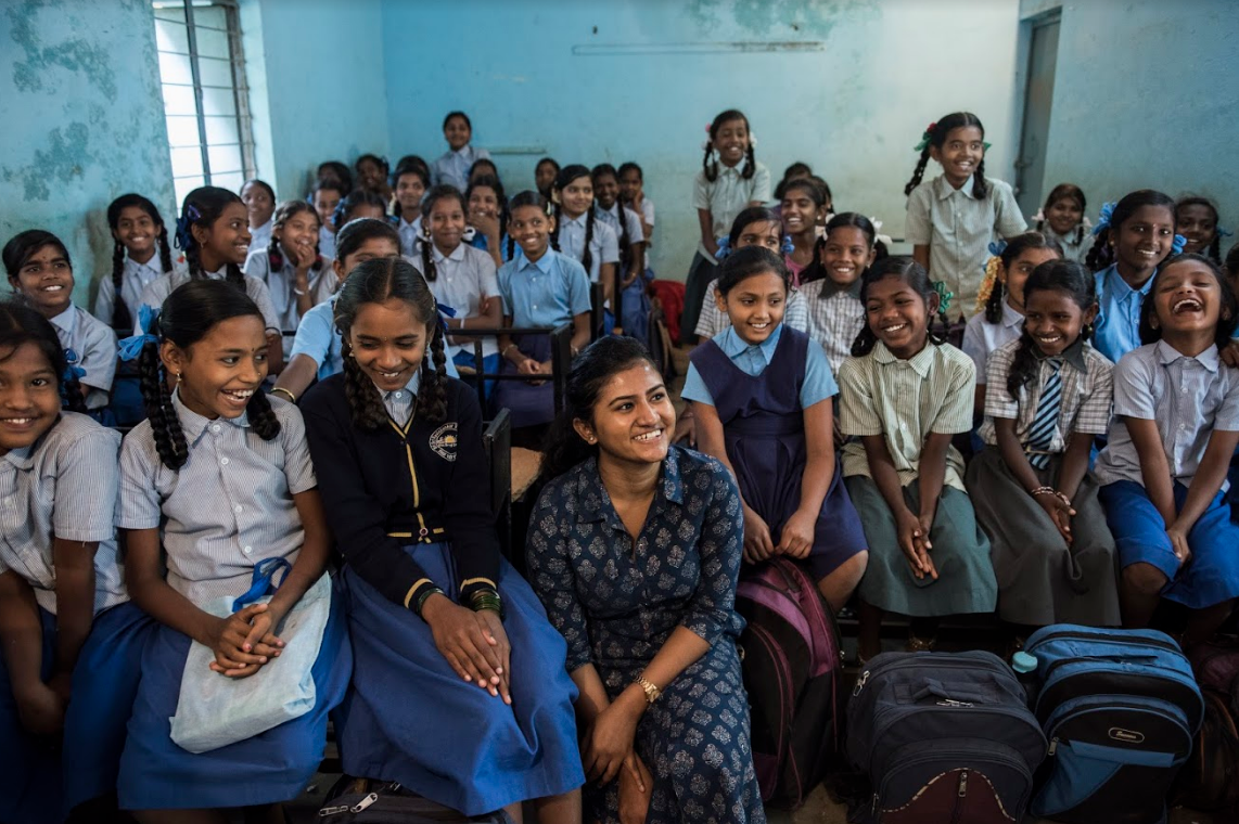 The girls pose for a picture with Amritha Subramaniam after the end of a two-day workshop at a government school in Bangalore, India.