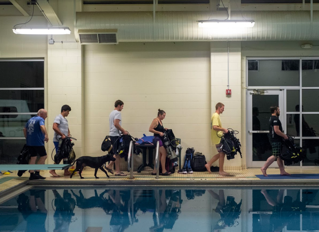 Participants in Tobin's scuba certification course work with a variety of equipment, such as the self-contained underwater breathing apparatus.