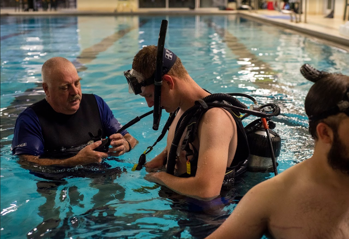 Tobin works carefully to equip students with skills needed for scuba diving.