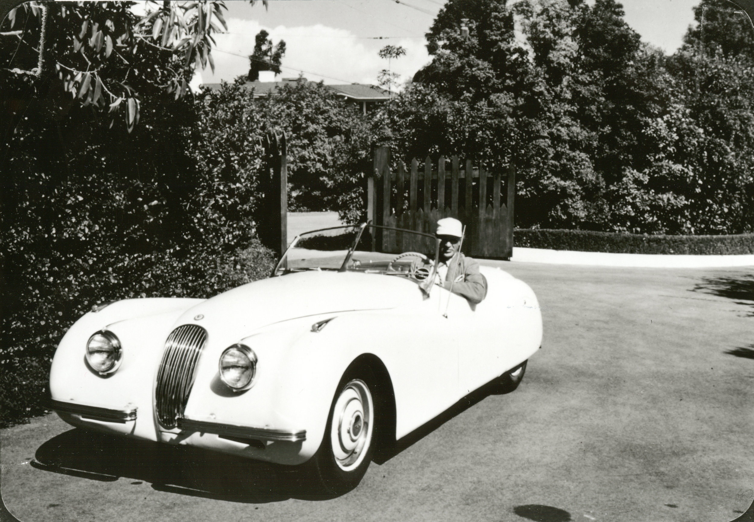 "- Being out in nature or behind the wheel of his favorite cars was when Gary Cooper was at his happiest.Here, this special, ""souped up"" Jaguar was part of his stable."
