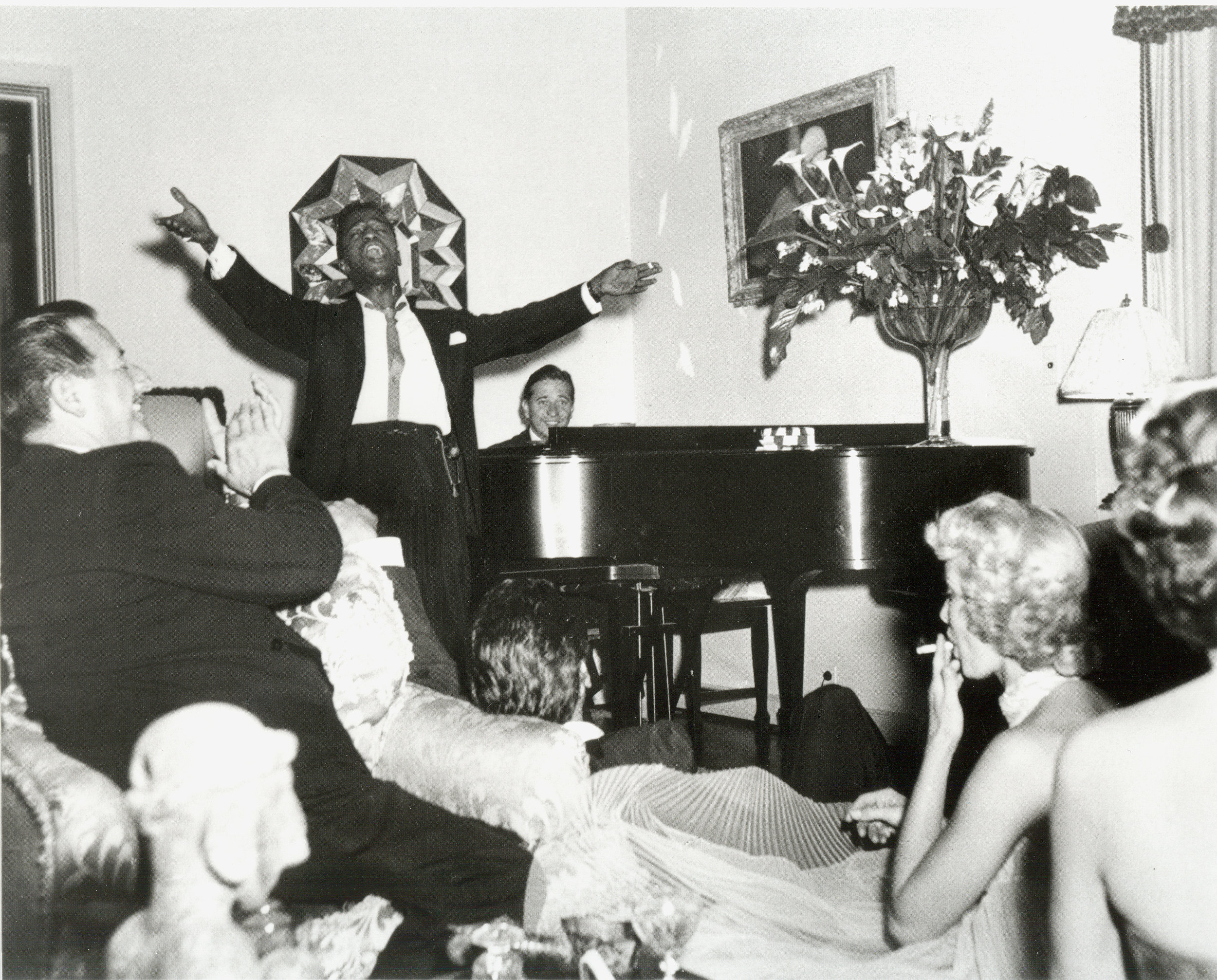 - A party at home… We all had the great pleasure of hearing Sammy Davis jr.seranade us after dinner. He had recently moved to Hollywood and in this photo joined in the after dinner jam sessions that often happened around our piano —making music with some of our friends like Judy Garland, Sinatra or Tony Martin.