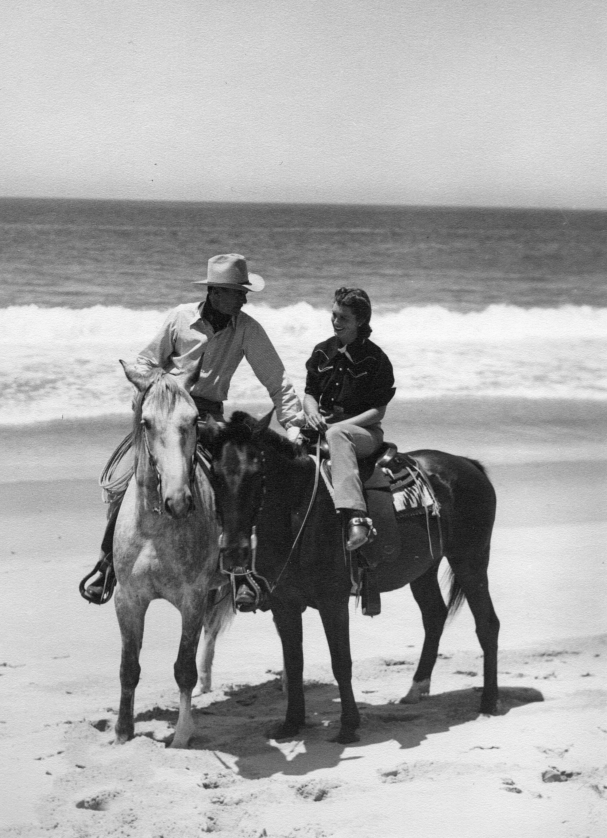 - A favorite weekend getaway - riding on the beaches near Malibu. They kept the horses up in the hills and it was a welcome gallop on the sand at the edge of the surf. It looks like my mother was enjoying the special attention of her husband.