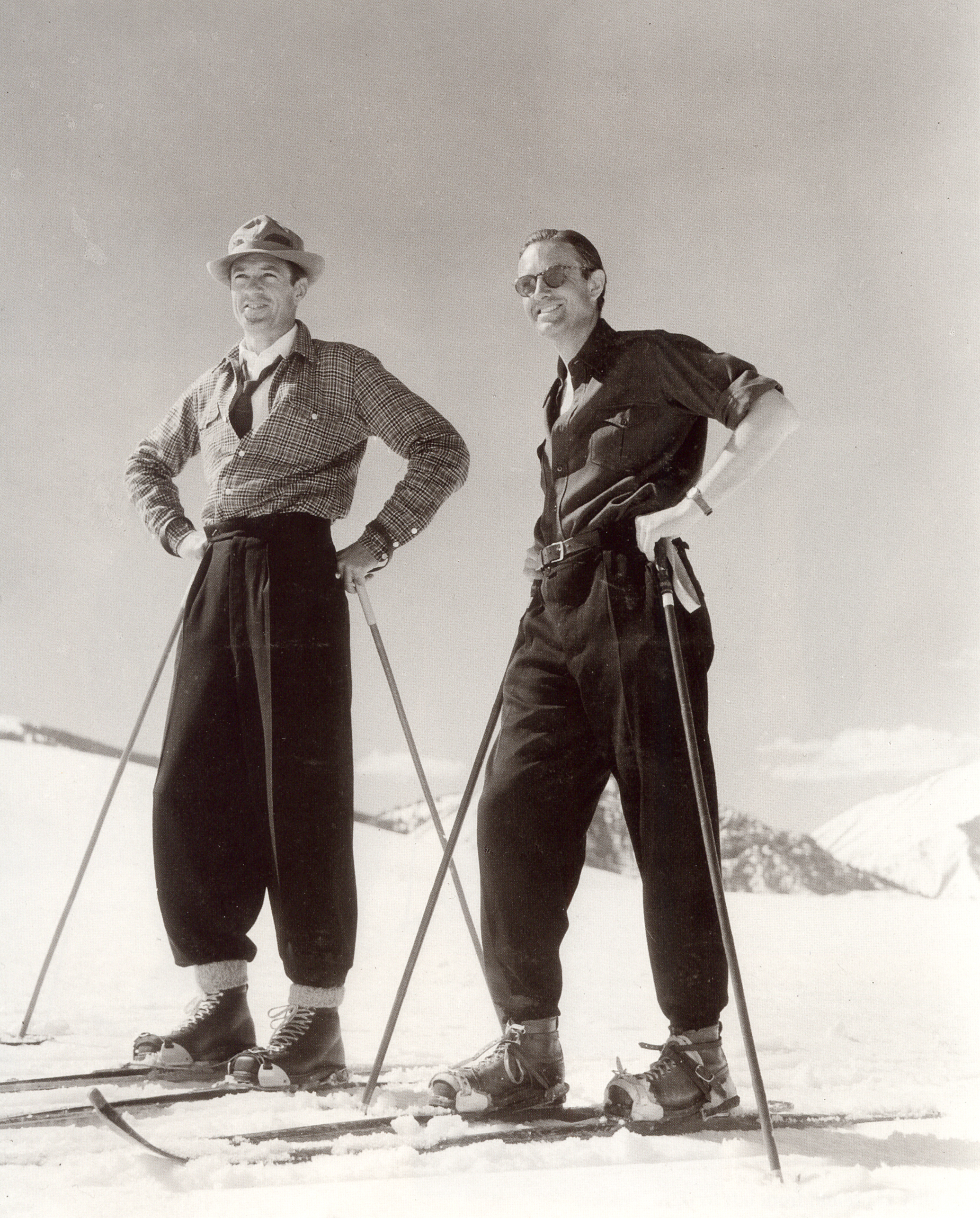 "- Gary Cooper and Avril Harriman ..to be Gov. of NYC in the future, but then responsible for starting the famed resort of Sun Valley . He and my father wearing their ""Swiss Baggies"" not exactly the GQ fashion standards of skiing of today!"
