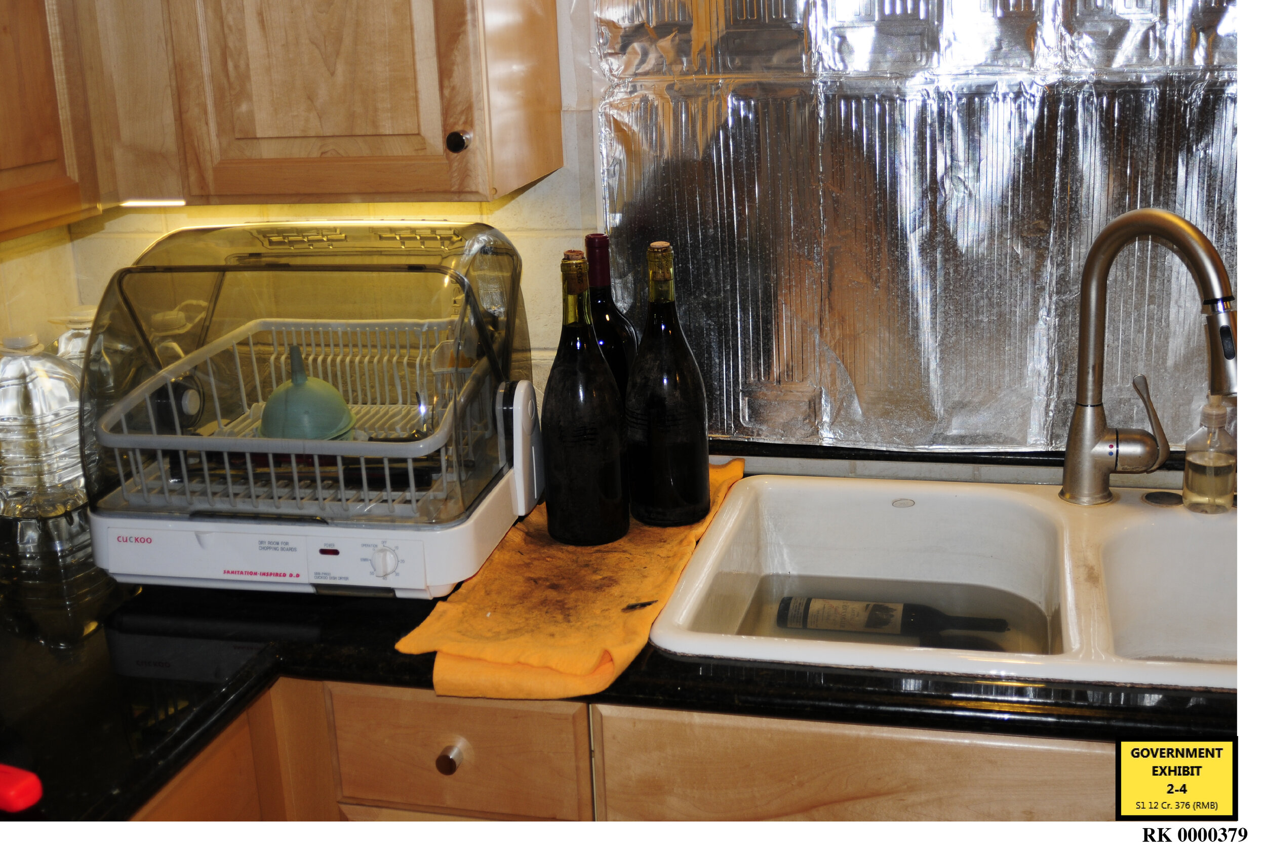Some counterfeit bottles and the equipment found by the FBI in Kurniawan's house in California