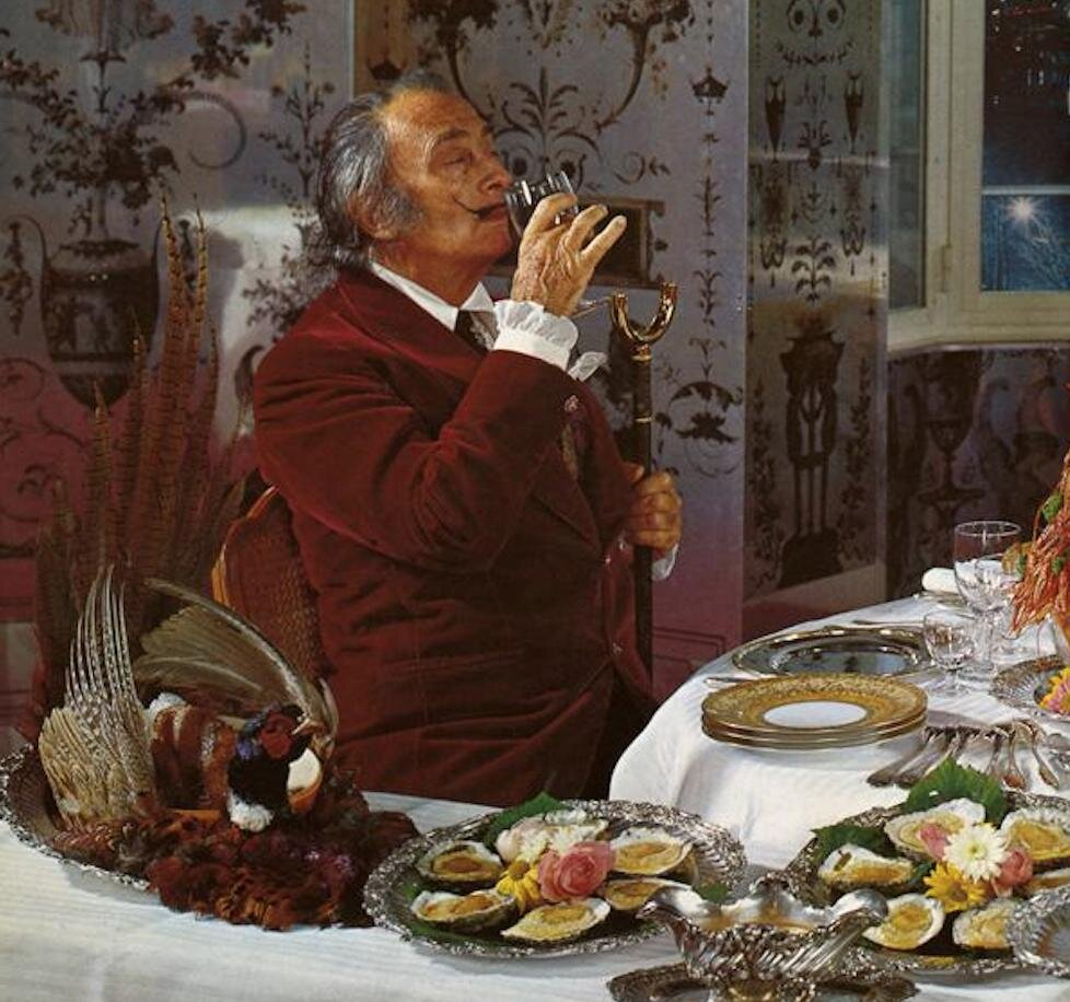 Salvador Dalí pictured enjoying wine in his book 'The Wines of Gala' (1977)