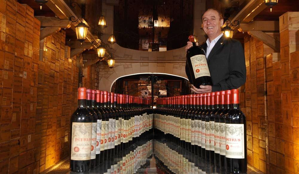 Chasseuil holds some beloved Pétrus Pomerol bottles in his cellar (credit: Facebook/M.J. Chasseuil)