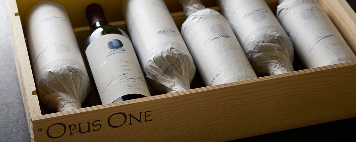 A beautifully crafted case with bottles of Opus One, the Mondavi-Rothschild masterpiece wine we offered in 2020