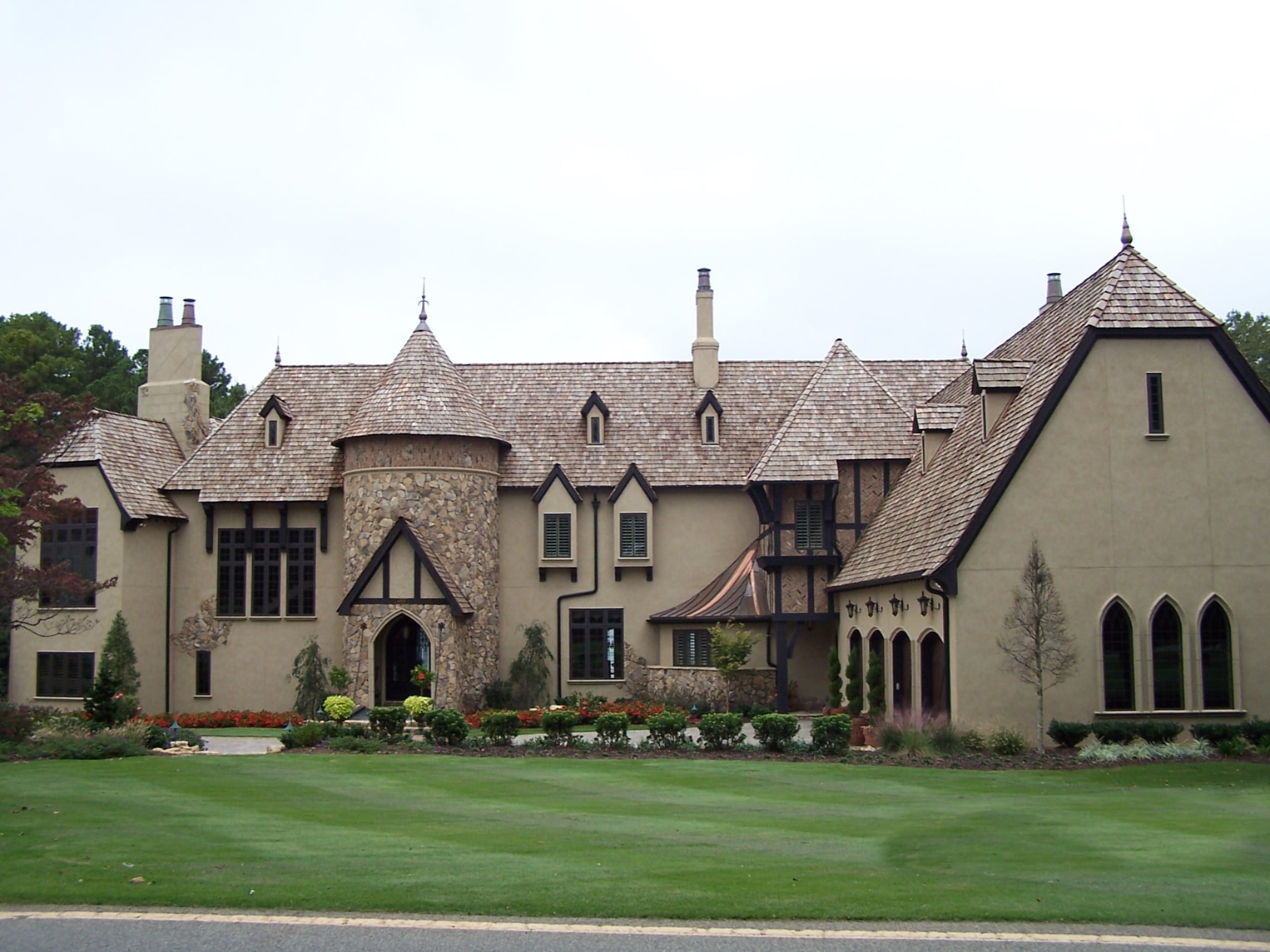 Beautiful Old World home with stucco and stone. Cedar shake roof adds to the old world charm.