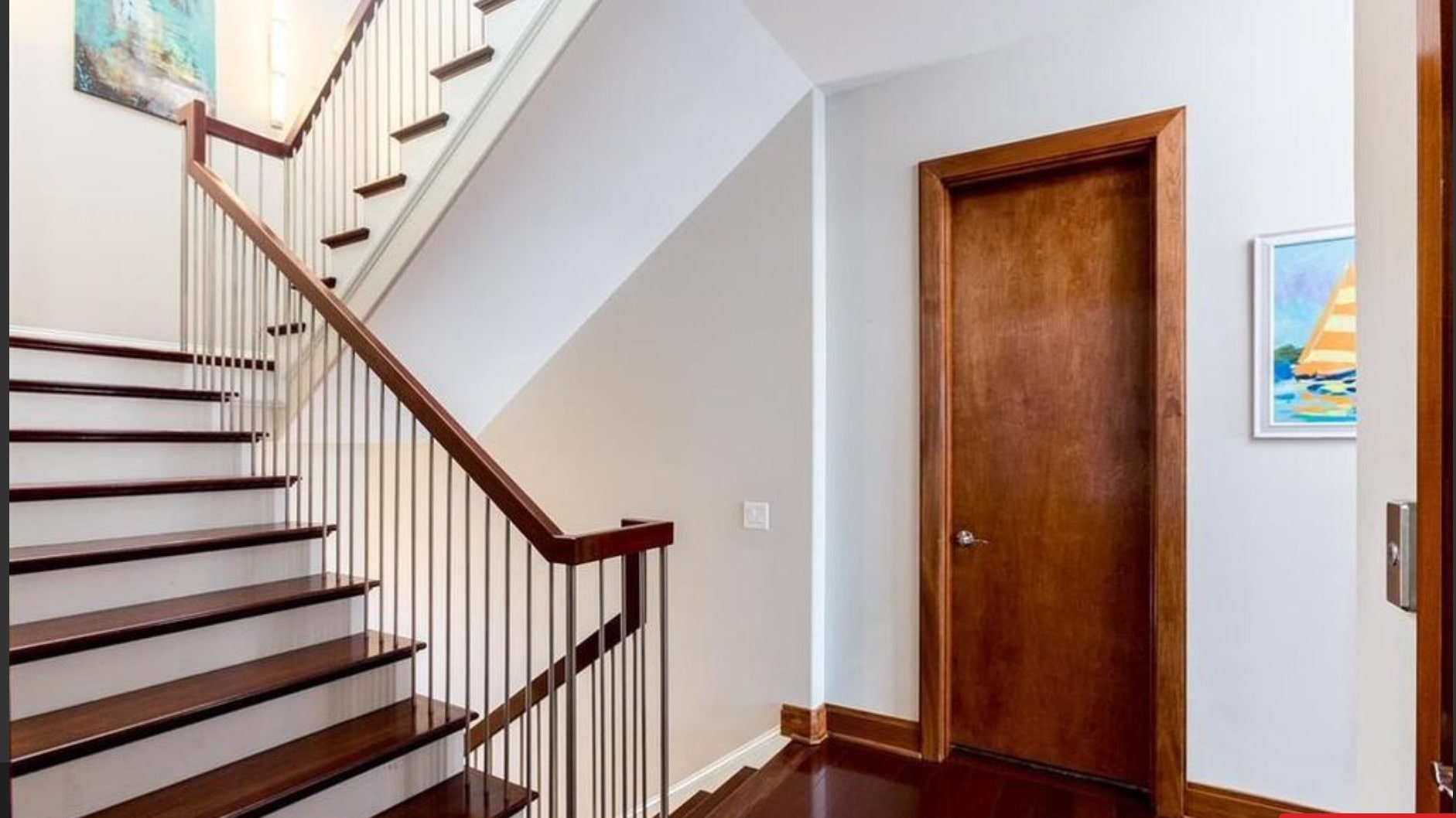 Gorgeous custom built staircase takes you to all levels of this home.