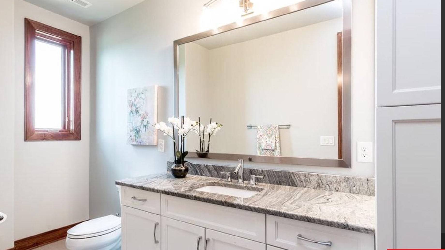 Guest bathroom with granite counter top.