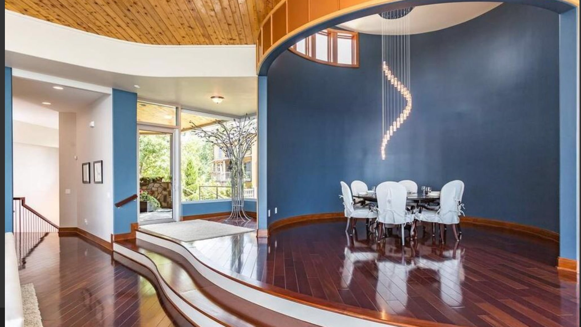 Dining area with custom chandelier designed to accentuate the space.