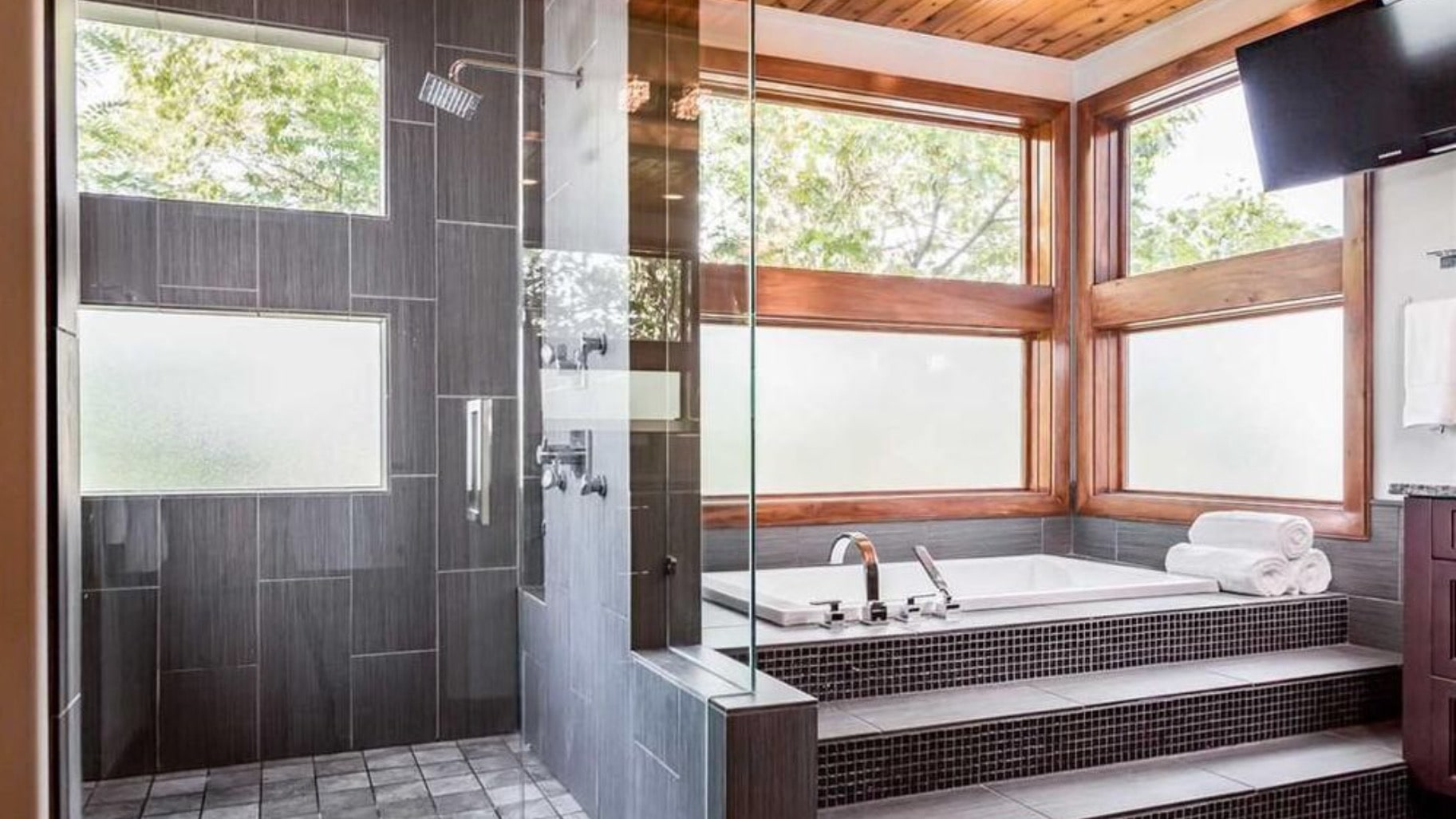 Master bath with frosted and clear glass to let in as much natural light as possible while still providing privacy.