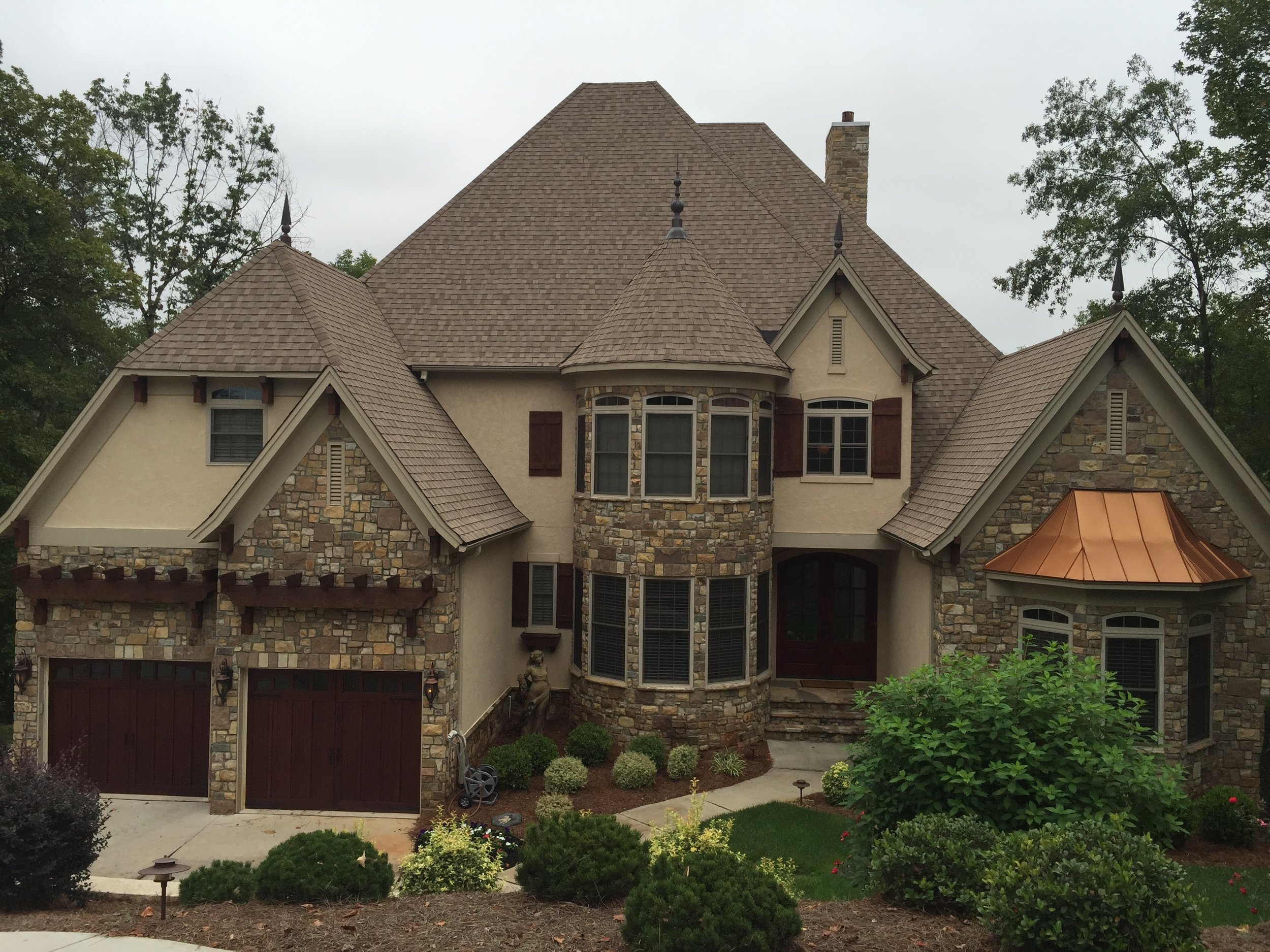 Traditional stone and stucco home on Lake Norman with beautiful wood accents.