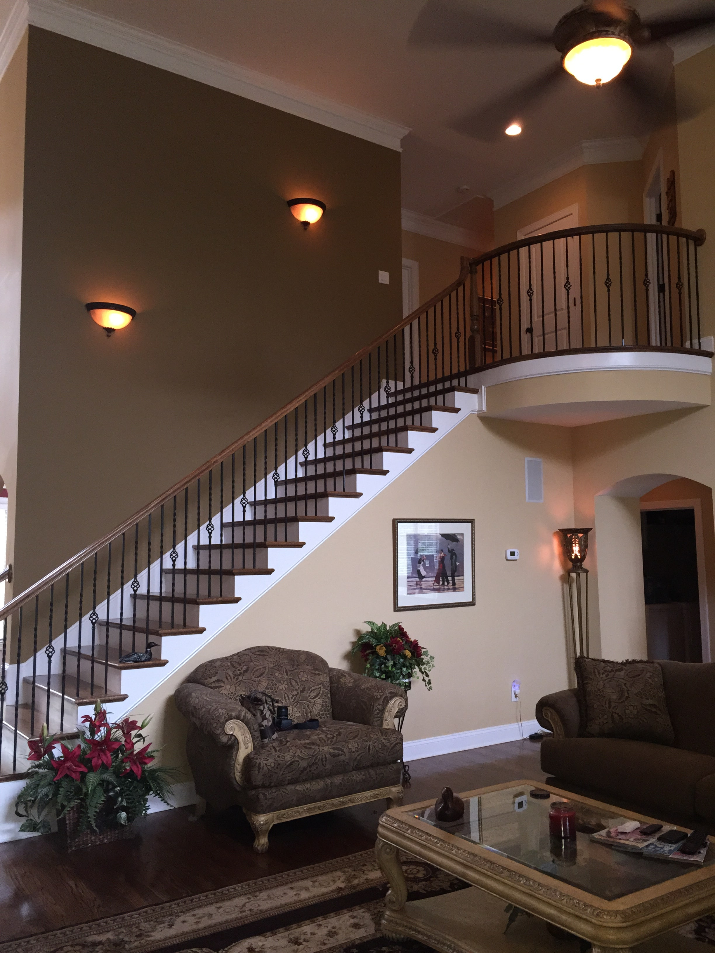 Living room with gorgeous staircase.