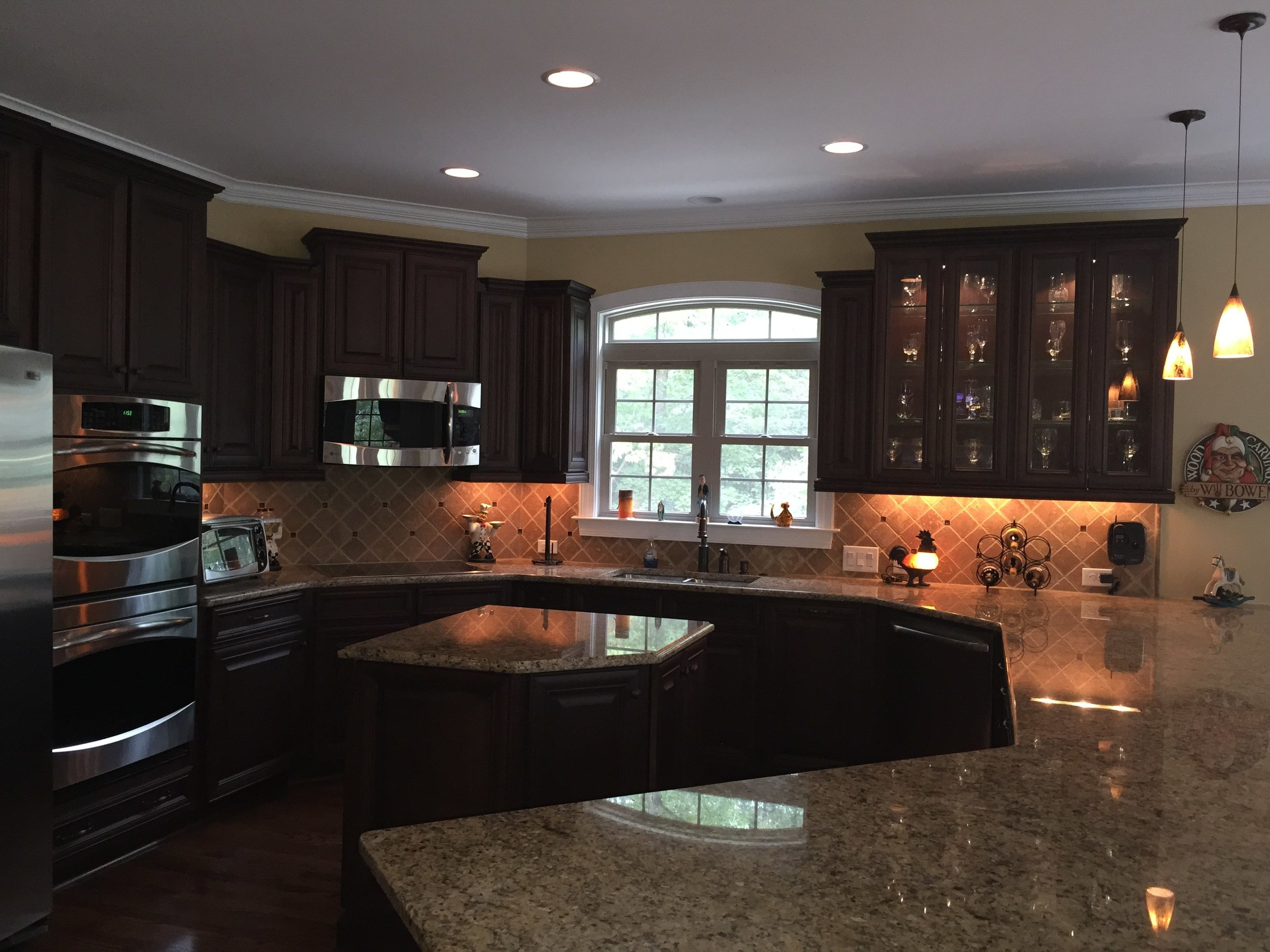 Large kitchen with custom cabinetry and island.  Granite counter tops offer lots of space for entertaining.