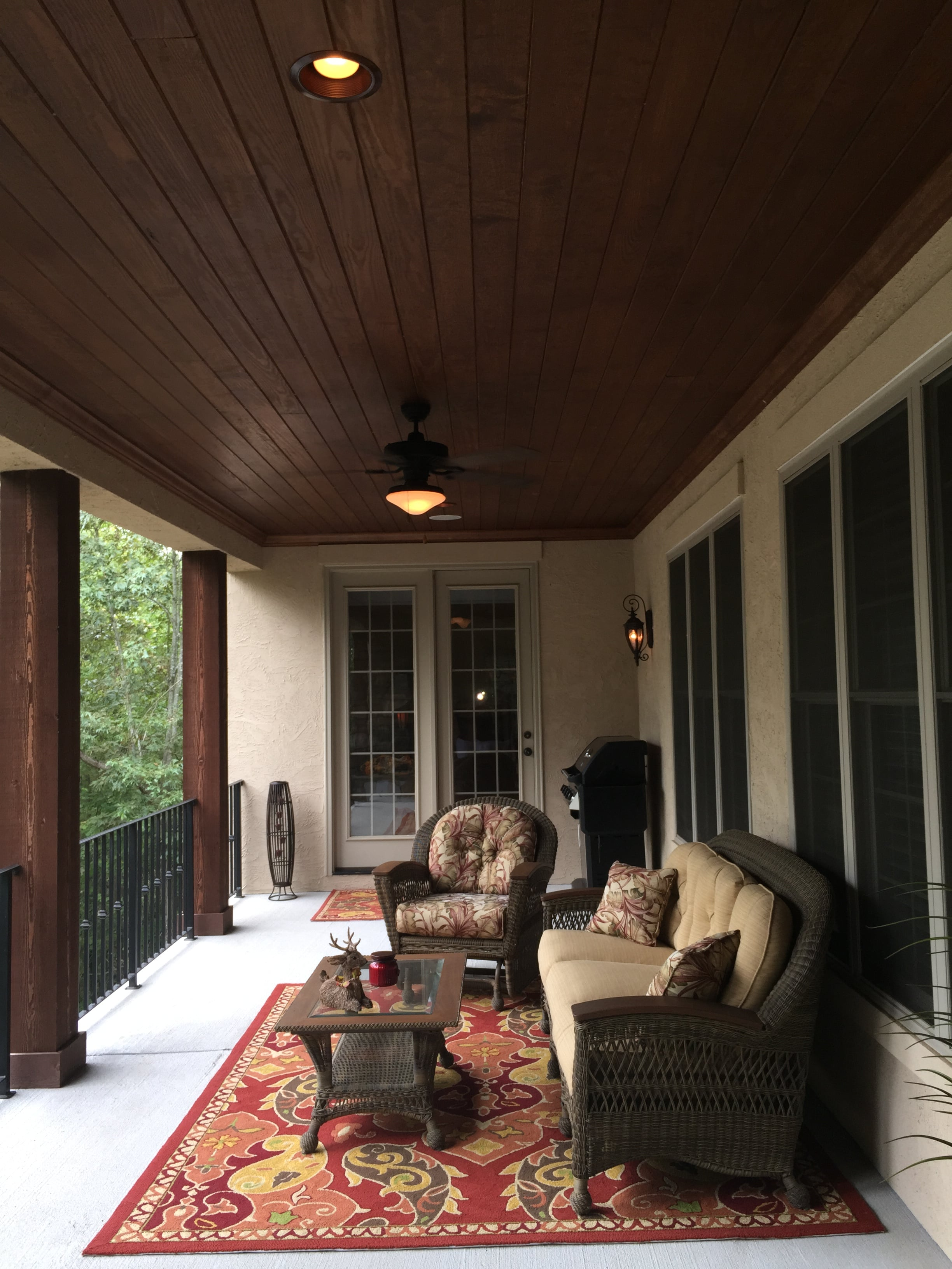Main level covered porch with tongue and groove wood ceiling overlooking the lake.