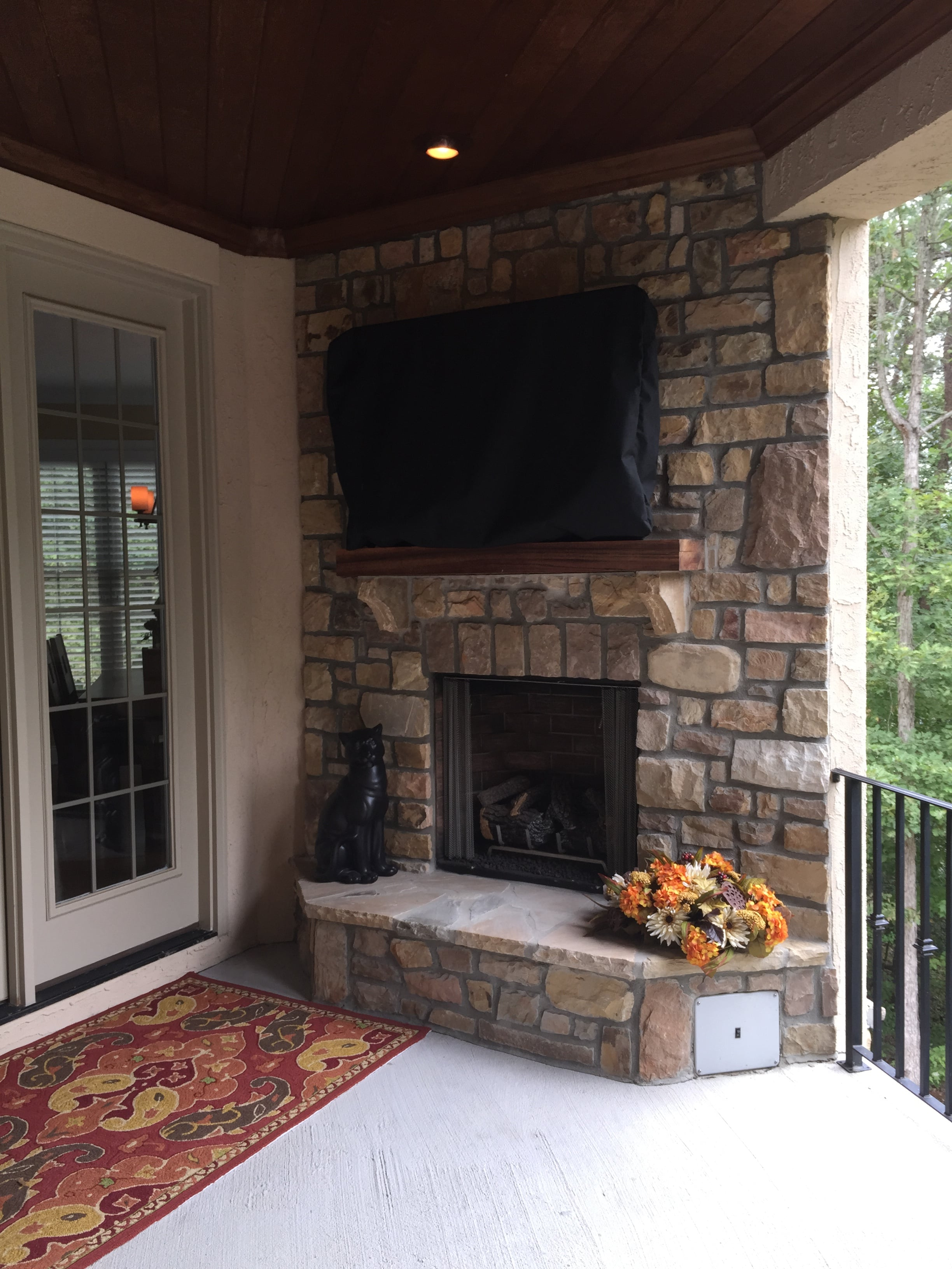 Beautiful stone fireplace on main level covered porch.