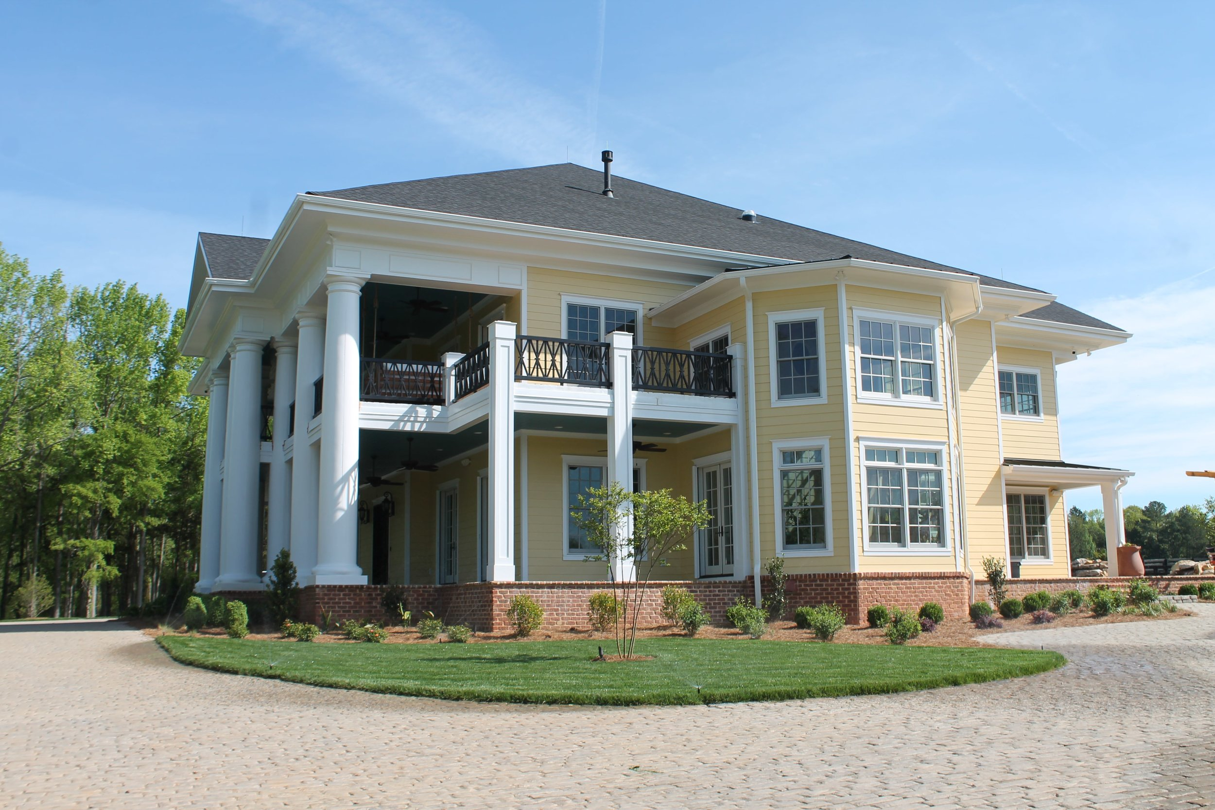 Beautiful southern estate on large acreage in South Carolina.  Double front porches with brick pavers enhance the beauty of this masterpiece.