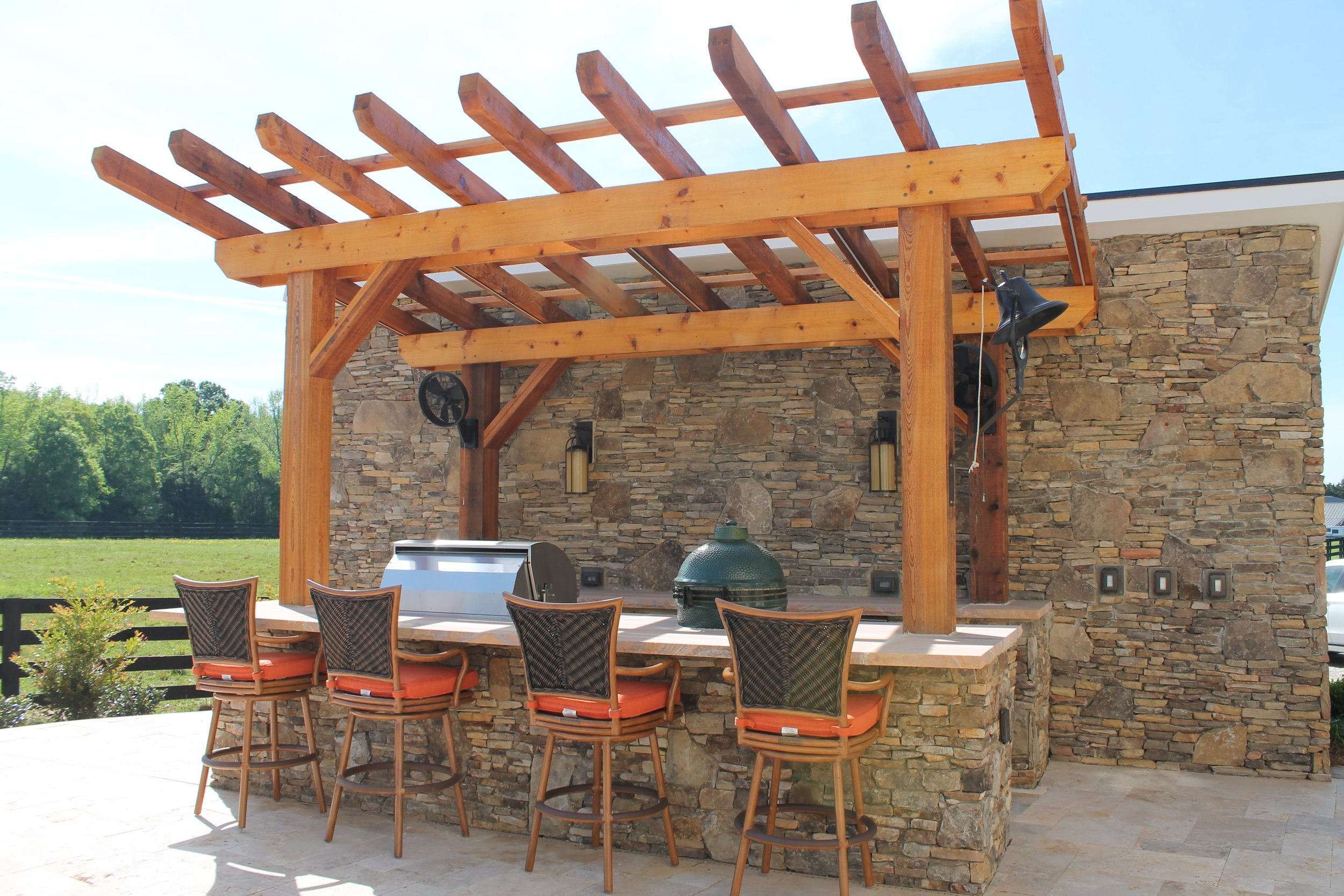 Outdoor grilling and entertaining space with cedar pergola.